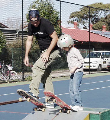 Coach Danny teaching a student how to drop-in at a Skate Now skateboarding lesson