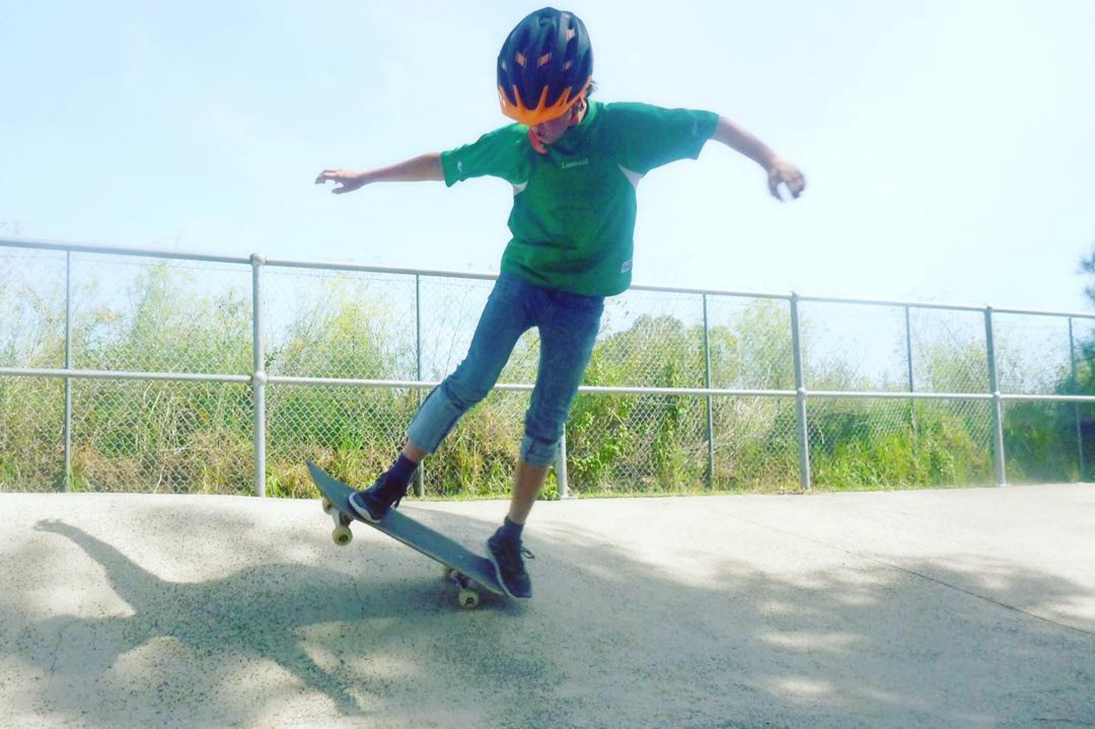 A young skater riding Dulwich Hill skatepark at a Skate Now skateboarding lesson